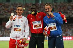 (L-R) Silver medalist Adam Kszczot of Poland, gold medalist David Lekuta Rudisha of Kenya and bronze medalist Amel Tuka of Bosnia and Herzegovina pose on the podium during the medal ceremony for the Men's 800 metres during day five of the 15th IAAF World Athletics Championships Beijing 2015 at Beijing National Stadium on August 26,