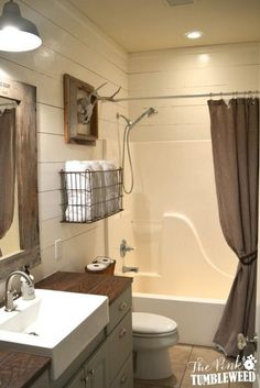 Rustic Bathroom With Wire Towel Basket Over The Toilet.