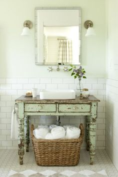 2012 Idea House: Farmhouse Restoration: Vintage Bathroom: Give a new room instant age. A perfectly worn painted table breaks up the sea of white tile and carries on the farmhouse look. Keep tile classic. White subway-style tiles by Daltile pai Rustic Bathrooms, Vintage Bathrooms, Modern Bathroom, Guest Bathrooms, Bathroom Interior, Unique Bathroom Sinks, Modern Sink, Simple Bathroom, Bathroom Inspiration