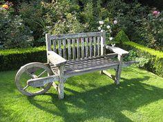 Wheelbarrow garden bench at Abbey House Gardens in Malmesbury, England.