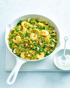 We've used packets of microwave rice to cut down the cooking time on this gently spiced prawn and pea pilaf – ideal for a speedy midweek dinner. Pastas Recipes, Uk Recipes, Dinner Recipes, Cooking Recipes, Cooking Time, Rice Recipes, Indian Recipes, Cooking Classes, Sin Gluten