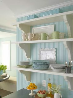 "Open Shelving with Tiffany Blue walls...very classy    Shelf Solutions - use 1/2"" pine boards with 1 1/2"" pieces of flat stock pine attached to the front of each shelf giving the illusion of hefty (and pricey) shelving.  Open shelves help make this galley kitchen seem larger and are a great way to store kitchen essentials. -- this would look cute in my dining room!"