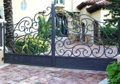 Wrought iron driveway gate with automatic opener.