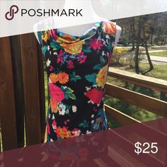 NWT Tahari Floral Blouse with Cowl Neck Vibrantly colored Floral pattern Blouse. This is perfect for spring and can be paired with a blazer or cardigan for a professional look or dressed down with shorts, capris, jeans...you name it, for a more casual look. New with tags Tahari Tops Blouses