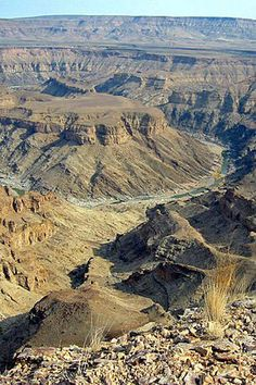 The Fish River Canyon, ǀAi-ǀAis/Richtersveld Transfrontier Park, Namibia A Far Off Place, The Good Place, Puffy Areolas, South Africa Wildlife, Great Places, Beautiful Places, Land Of The Brave, Sunrise Colors, Namib Desert