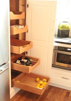 The best part of custom storage in your kitchen? You can utilize even the most awkward of extra spaces. A narrow, deep cabinet is easily made more useful with the addition of pull out drawers and shelving! Great way to store small appliances, canned goods, and pantry staples.  #dovetail #custom #pullout