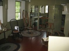 Photo taken 2011 of the Old Kitchen in the Historic Atwood House. Seen here, the table, chair, spinning wheel and entrance to the pantry area. #kitchen, #pantry, #atwoodhouse, #chathamhistoricalsociety, #chatham, #capecod