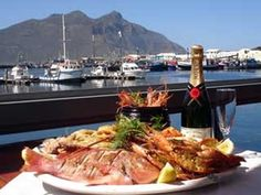 Can't miss! The Lookout Deck (Hout Bay) offers amazing sea views paired with delicious seafood and champagne.