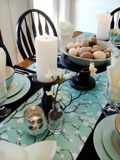 A blossom-detailed table runner and a simple egg-filled bowl adds a fresh, farmhouse feel to this spring-themed dinner party.