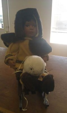 Porcelain Eskimo Girl On Sled - $20