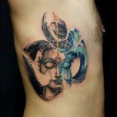 Buddha within Om 'watercolour' tattoo.