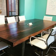 Reclaimed thick conference room/ board room table with grommet.