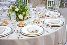 """Pobierz zdjęcie royalty free  """"A table set for a reception"""" autorstwa Cristina Annibali w najniższej cenie na Fotolia.com. Przeglądaj naszą bazę tanich obrazów online i odnajdź doskonałe zdjęcie stockowe do Twoich projektów reklamowych!"""