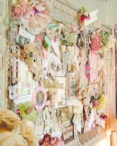 A beautifully organised, vintage craft room. Full of vintage wallpaper, pretty storage and even prettier displays of trinkets and vintage knick knacks