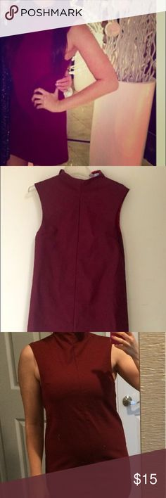 """Tobi high neck burgundy sleeveless shift dress Very cute high neck dress. Hidden zip in back. Pretty burgundy color. Made of very nice material.  This is a re-posh. The cover shot is person I bought from. For reference she is 5'5"""" and wears a size 6 dress normally.  This dress fits me, but not like I pictured, So this should belong to someone else and actually get worn 😊 Tobi Dresses Mini"""