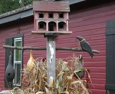 black crow on primitive stick heart cutout gourds and birdhouses