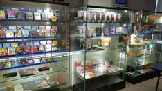 Glass Display Case w/ LED Side Lights, Sliding Door, Frameless - Black Glass Shelves, Wall Shelves, Industrial Shelving Diy, Glass Display Case, Store Displays, Store Design, Sliding Doors, Space Saving, Coffee Shop