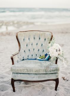 Bouquet by Ever After Event & Floral Design, vintage pale blue velvet chair from Love in Vintage. Image by Melanie Gabrielle. #wedding www.weddingsunveiledmagazine.com