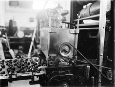 Chocolates passing under a machine along a conveyor belt, MacRobertson Chocolate factory  ca. 1910
