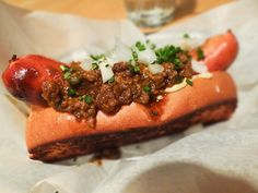 Hot dog with brisket chili, pimento jack, and sweet onion