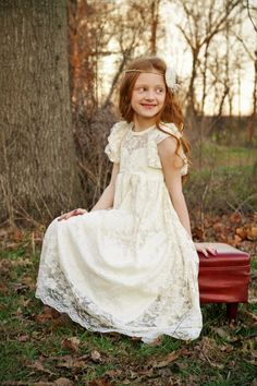 This stunning ivory or white lace flower girl dress is made from the softest lace. Delicate lace flutter sleeves make this dress feel so