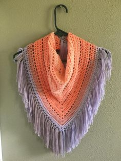 Multi colored triangle scarf with fringe I used Lion Brand Mandala yarn, it's 10p% acrylic but feels light and soft next to the neck. It would look awesome in the fall or the dead of winter! Made in a smoke and animal free home I used this pattern to make this scarf, it's a bit smaller then what she made but that's because the yarn I used was different. http://www.hookedonhomemadehappiness.com/piece-cake-triangle-scarf/