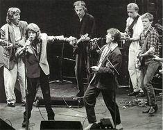 Paul McCartney, Mick Jagger, David Bowie, Mark Knopfler, Mark King, and Bryan Adams performing in London, 1986