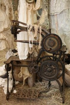 Wow. My vintage sewing  machine isn't this old, but what a cool look.
