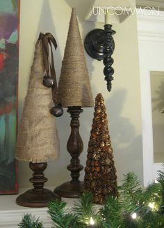 trees/candlesticks...styrofoam cones wrapped in twin, burlap, and pinecones or sweetgums.  Great DIY