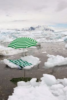 """Photographer Gray Malin's """"Antarctica: The White Continent."""" The contrast of Antarctica's immaculate landscape with that of ordinary everyday objects, to sensitize the audience on climate change."""