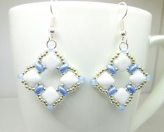 Blue and white silky bead beadwoven earrings by BuzzybeeBeading