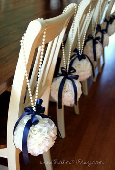 Ivory and navy blue wedding flower balls. Hanging flower pomander. Wedding pomanders. Pearl and navy blue. Two navy blue satin bows.   Custom orders: www.Psalm117.Etsy.com