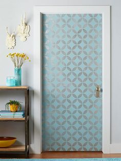 Door Panache  Make a grand entrance with a door that's dressed up with color and shine. We used aqua blue paint as the base color and a silvery metallic paint for the stenciled design.