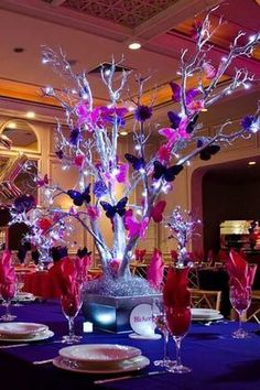 Butterfly tree quinceanera decorations tree centerpieces butterfly centerpieces butterfly theme butterfly wedding outdoor venues are a fantastic alternative to a conventional hall or ballroom a butterflytree Butterfly Tree, Butterfly Party, Purple Butterfly, Pink Purple, Butterfly Wedding Theme, Butterflies, Wedding Flowers, Diy Wedding, Wedding Reception