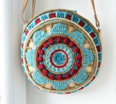 ** Round Mandala Bag crochet pattern (overlay and tapestry crochet) **  **** This listing is for the crochet pattern only! Finished bag is not included! ****  If you search for finished product please check it here: https://www.etsy.com/listing/219167369/crocheted-mandala-bag-round-purse-cross?ref=shop_home_active_7 The Wheel of Magic Crocheted Bag is of a practical size with a bit of depth and enough space for a mobile phone, wallet, keys, lipstick and even a small book. I used leather…