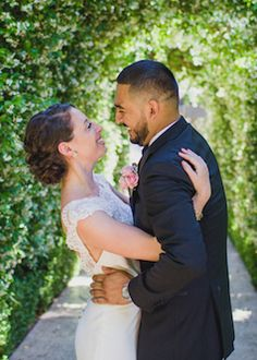 Loving embrace bride and groom captured by Cotton Love Studios | Los Angeles wedding photography videography