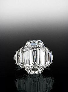 emerald center with side stones | Emerald cut center diamond with trapezoid diamonds on either side. By ...