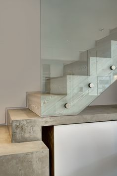 The mix of industrial bolts and stylish glass is great here!