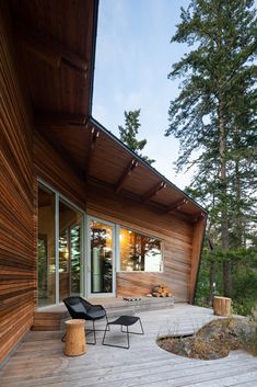 Black metal panels and angled wooden slats cover this pointed house Canadian practice Campos Studio has created for a woman and her dog living in Pacific Northwest rainforest. Arched Cabin, Steel Columns, Wooden Slats, Wooden Cladding, Wall Cladding, Wood Patio, Metal Panels, Brick Fireplace, Arquitetura