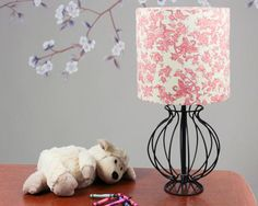 Made to order hand made drum lamp shade with fairy design pink and cream vintage fabric.  What a lovely way to brighten up your child's room. Delicate fairies in the tree branches, butterflies drifting softly by. Imagine sitting by the soft glow of this lamp to read with your little one. This is eye-catching decor for all ages and it'll make you feel happy just to look at it!
