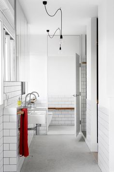 You can't beat the classic brick tile finish. Love the industrial style of this #bathroom