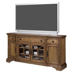 Radiata wood media console with elm veneers and handcrafted walnut inlay.   Product: Media consoleConstruction Materi...