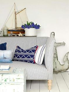 Muted Neutrals , Vintage Finds ,And Pops Of Nautical Blue Create this Cozy Kiawah Island Coastal Cottage !