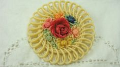 VINTAGE CELLULOID PAINTED FLOWER CENTER SCROLLED ROUND C CLAMP PIN BROOCH