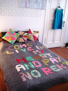 "Love this idea of sewing a word or phrase on a quilt... I'll have to contemplate it for my room! But mine will say ""Everything has beauty, you just have to seek it""!"