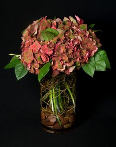 This is a floral arrangement that features red antique hydrangea.  See our entire selection at www.starflor.com.  To purchase any of our floral selections, as gifts or décor, please call us at 800.520.8999 or visit our e-commerce portal at www.Starbrightnyc.com. This composition of flowers is generally available for same day delivery in New York City (NYC).  V256