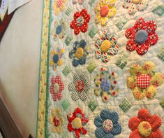 Inspiration to finish my Granny Flower quilt. love the little green corner covers.