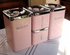 pink vintage kitchen tins - to go with the pink Sunbeam mixer and nesting pink bowls we found in that great antique shop in Rogers