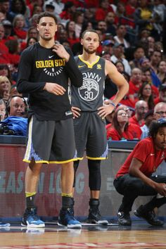 3774d683121 Klay Thompson and Stephen Curry of the Golden State Warriors look on  against the New Orleans