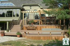 Large, high, 3-level spa deck with a pergola (#3RHS7045).